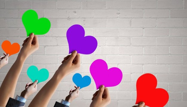 people holding hearts