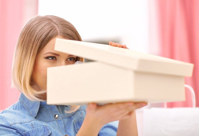 Woman peering into a box